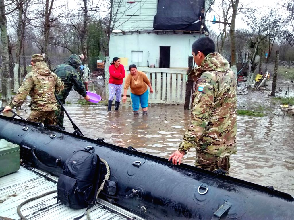 Military personnel help residents in a flooded area in the province of Buenos Aires, Argentina, on Aug. 15, 2015. According to information issued by the ...