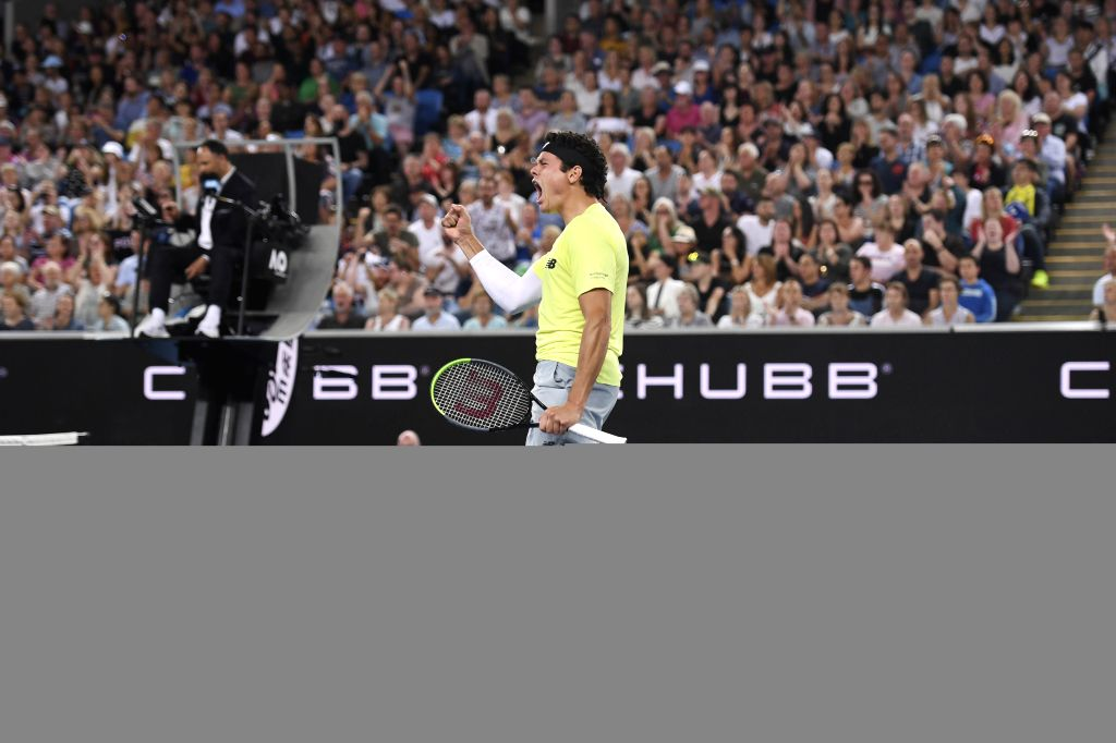 Milos Raonic of Canada celebrates after winning the men's singles third round match against Stefanos Tsitsipas of Greece at the 2020 Australian Open tennis ...
