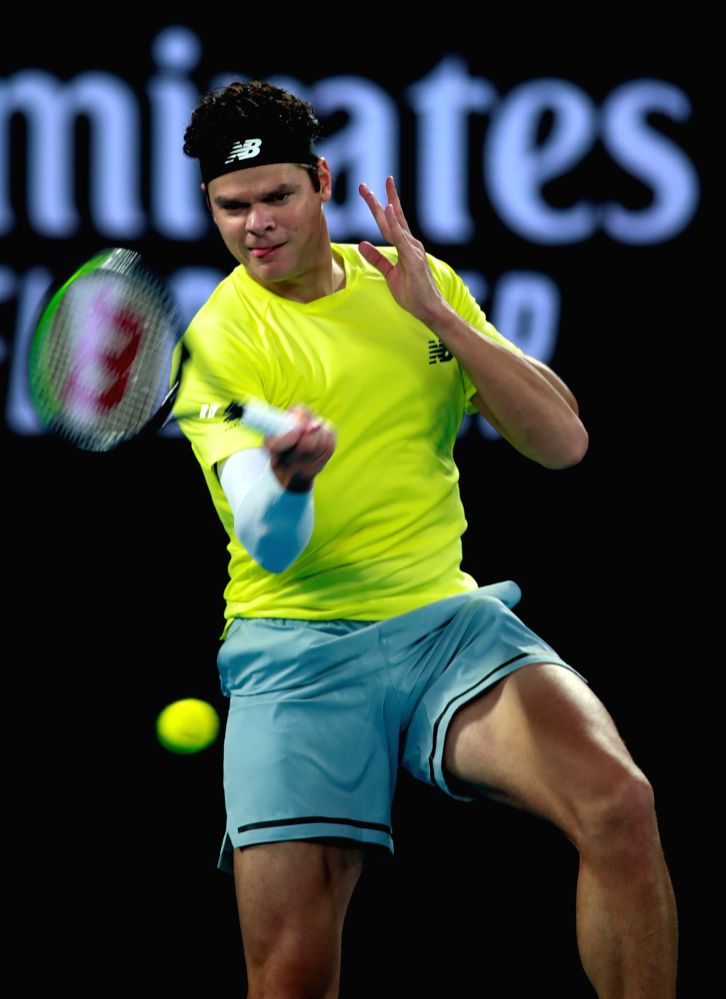 Milos Raonic of Canada hits a return during the men's singles quarterfinal match against Novak Djokovic of Serbia at the Australian Open tennis championship in ...