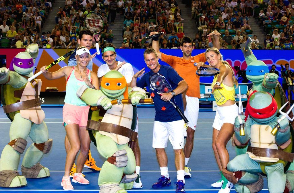 Milos Raonic (rear) of Canada, Caroline Wozniacki of Denmark, Roger Federer of Switzerland, Lleyton Hewitt of Australia, Novak Djokovic of Serbia and Victoria ...