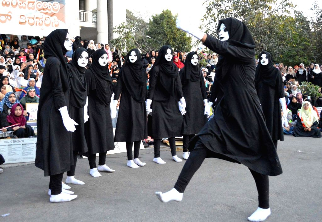 "Mime artistes perform a silent street play on ""Save Indian Constitution"" as part of a protest the Citizenship Amendment Act (CAA) 2019, National Register of Citizens (NRC) and ..."