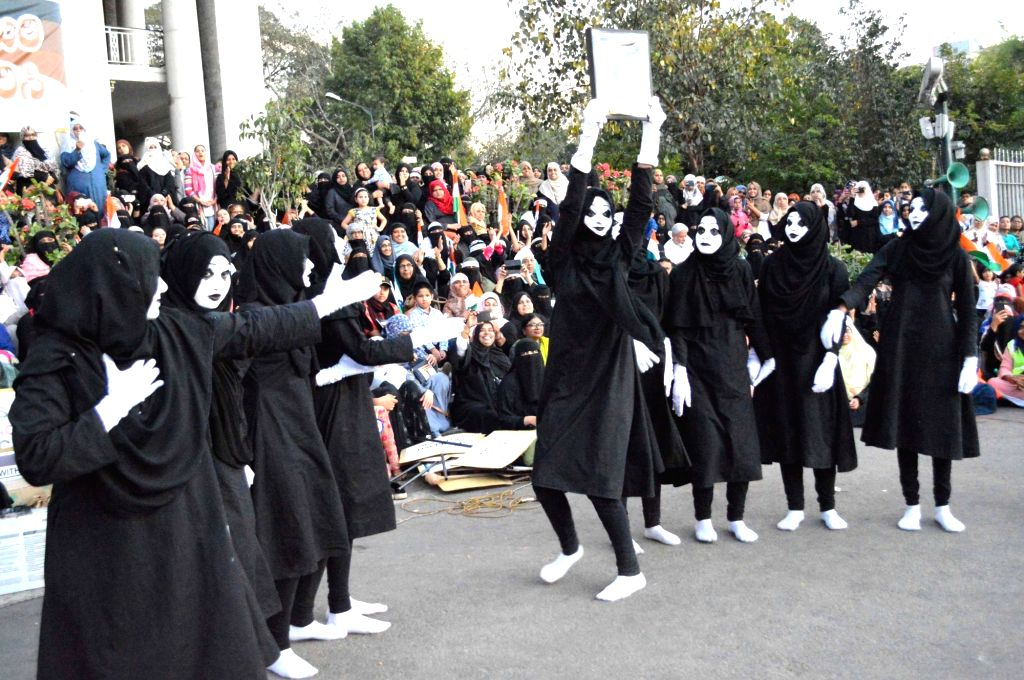 """Mime artistes perform a silent street play on """"Save Indian Constitution"""" as part of a protest the Citizenship Amendment Act (CAA) 2019, National Register of Citizens (NRC) and ..."""