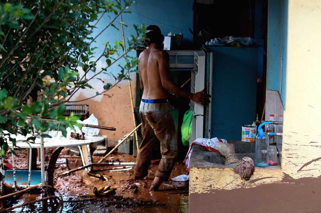 MINAS GERAIS, Jan. 26, 2019 - Photo taken on Jan. 25, 2019 shows a resident inspecting debris after the collapse of a dam in Brumadinho Municipality in the southeastern state of Minas Gerais, Brazil. ...