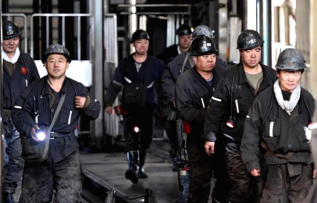 Miners walk out of the well of a coal mine after assisting with the rescue operations in Jixi City, northeast China's Heilongjiang Province, Nov. 22, 2015. Rescuers on ...