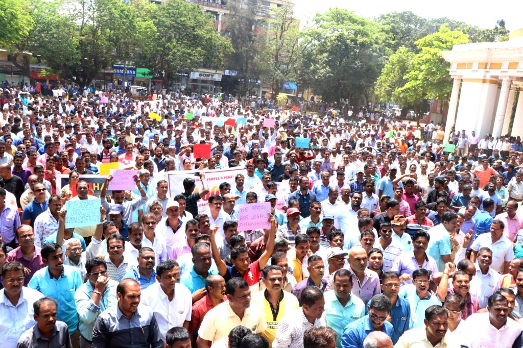 Mining dependents from across Goa stage a demonstration demanding the resumption of mining in the state, at Azad Maidan in Panaji on March 14, 2019.