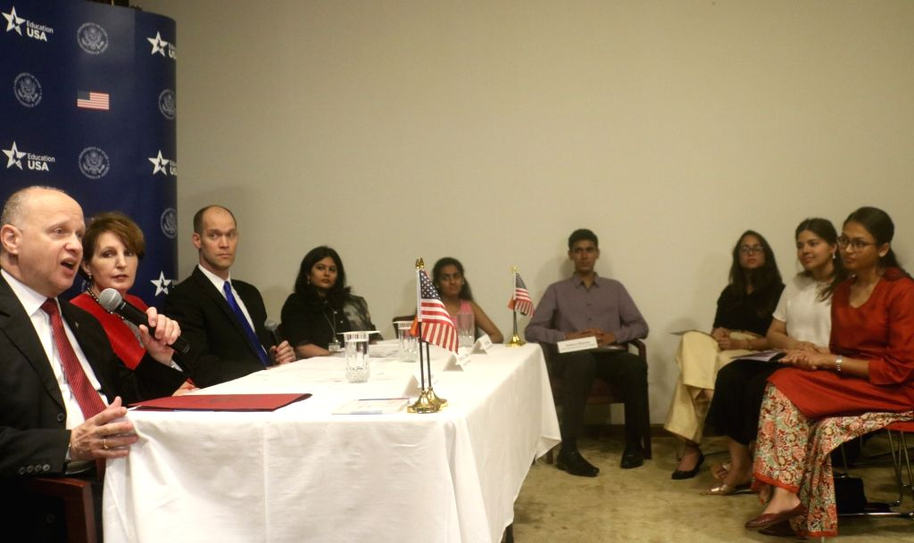 Minister Counsellor at the American Embassy in India Joseph Pomper along with Charge d'Affaires of the US Embassy in New Delhi, MaryKay Carlson, addresses student visa applicants during a ... - Counsellor