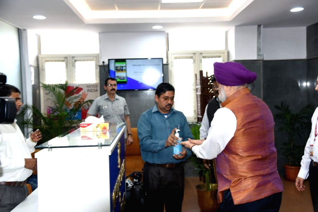 Minister of Civil Aviation of India, Hardeep Singh Puri using sanitiser at a meeting with other Ministers to tackle COVID-19 (coronavirus), in New Delhi on March 19, 2020. - Hardeep Singh Puri