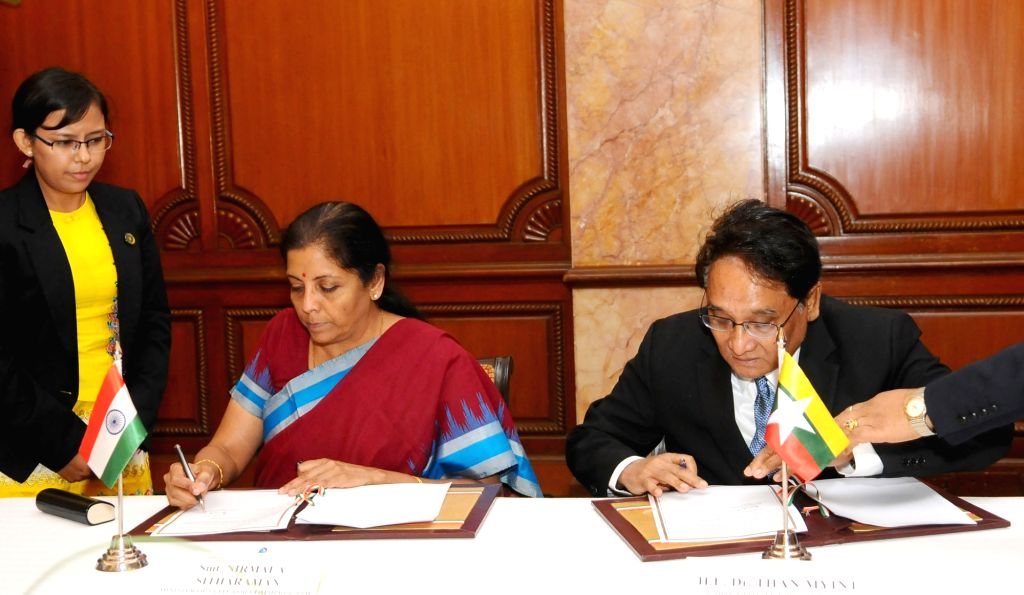 Minister of State for Commerce & Industry (Independent Charge) Nirmala Sitharaman and the Myanmar Commerce Minister Dr Than Myint signs the minutes, at the 6th Joint Trade Committee ... - D