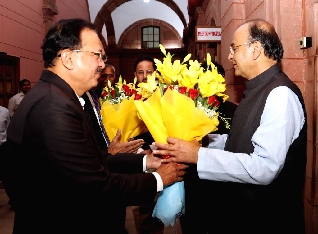 Minister of State for Defence Dr. Subhash Bhamre receives Union Minister and BJP leader Arun Jaitley on his arrival at South Block to take additional charge as the Union Defence Minister, ... - Arun Jaitley
