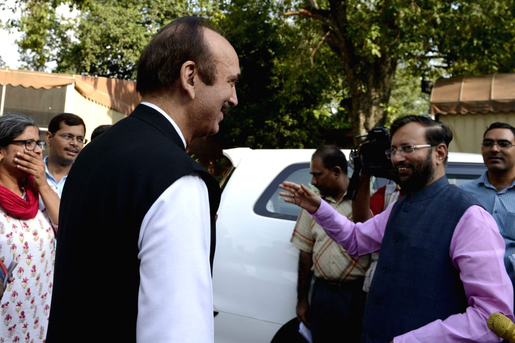 Minister of State for Environment, Forest and Climate Change (Independent Charge) Prakash Javadekar and Congress leader Ghulam Nabi Azad at the Parliament in New Delhi, on Aug 3, 2015.