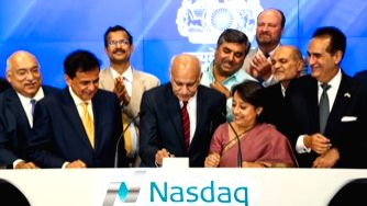 Minister of State for External Affairs M J Akbar and India\'s Consul General Riva Ganguly Das ring the closing bell at the NASDAQ stock exchange in New York on Monday, Aug. 15, 2016, to mark India\'s ...