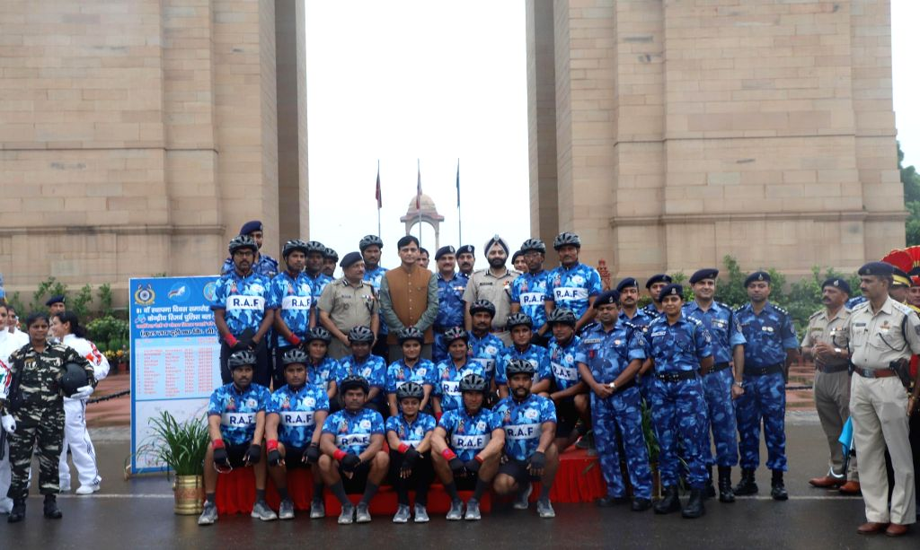 Minister of State for Home Affairs, Nityanand Rai with the the Rapid Action Force cycle expedition contingent from Ahmedabad, at the 81st Raising Day of the Force at India Gate, in New ... - Nityanand Rai