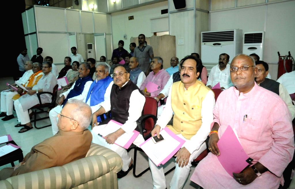 Ministers waiting during the swearing in ceremony of Bihar's cabinet ministers at Raj Bhavan in Patna on July 29, 2017.