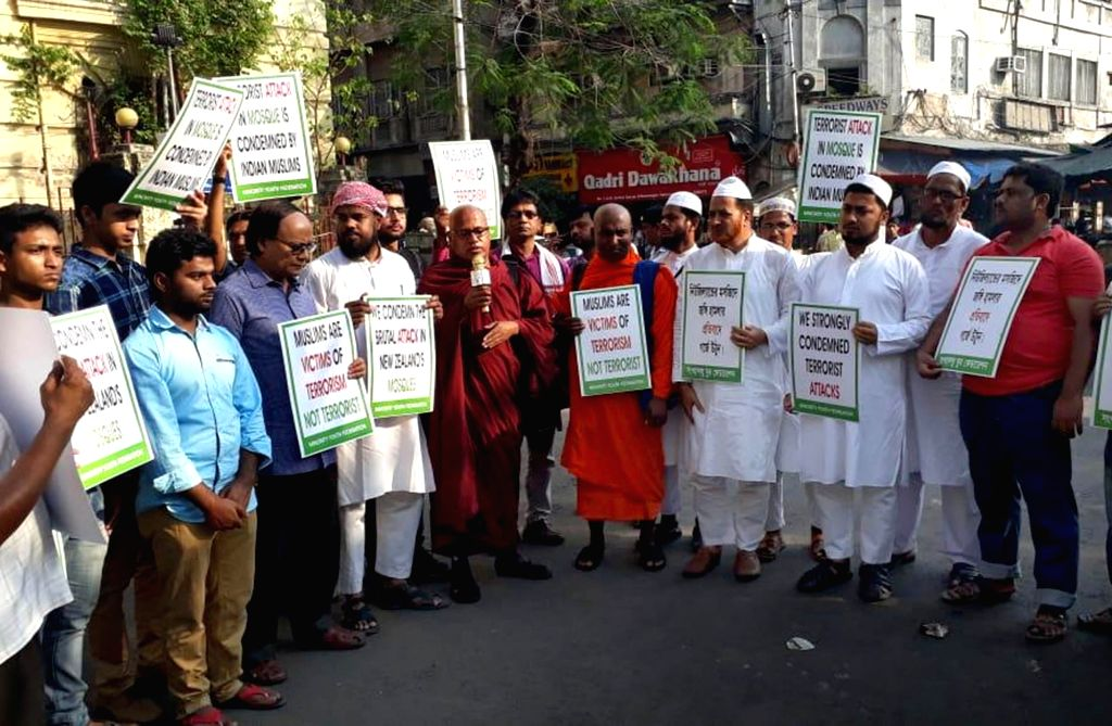 Minority Youth Federation activists stage a demonstration condemning the terrorist attacks at two mosques in New Zealand, in Kolkata on March 16, 2019.