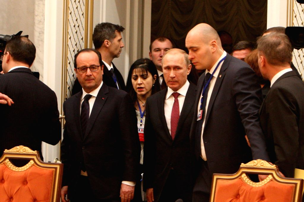 French President Francois Hollande (1st L, front) and Russian President Vladimir Putin (C, front) arrive for the four-way peace talks on the Ukraine crisis in Minsk, .