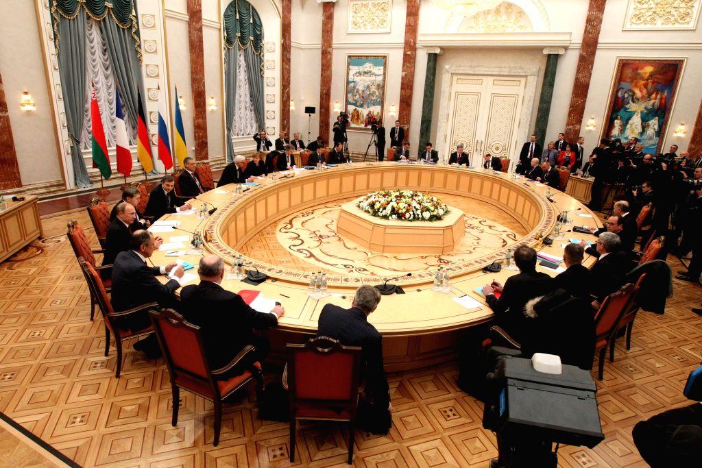 Photo taken on Feb. 11, 2015 shows the four-way peace talks on the Ukraine crisis in Minsk, Belarus, on Feb. 11, 2015. Four-way peace talks on the Ukraine crisis ...