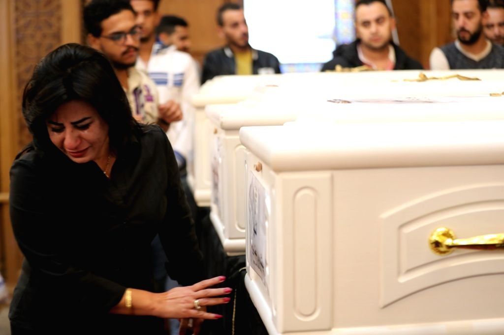 MINYA, Nov. 3 A women reacts during the funeral of people who were killed in an attack at the Prince Tadros Church in Minya, Egypt, on Nov. 3, 2018. At least seven people were killed and ...