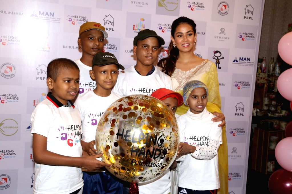 Mira Rajput, wife of actor Shahid Kapoor with Helping Hands' children during a programme in Mumbai, on Feb 13, 2019. - Shahid Kapoor