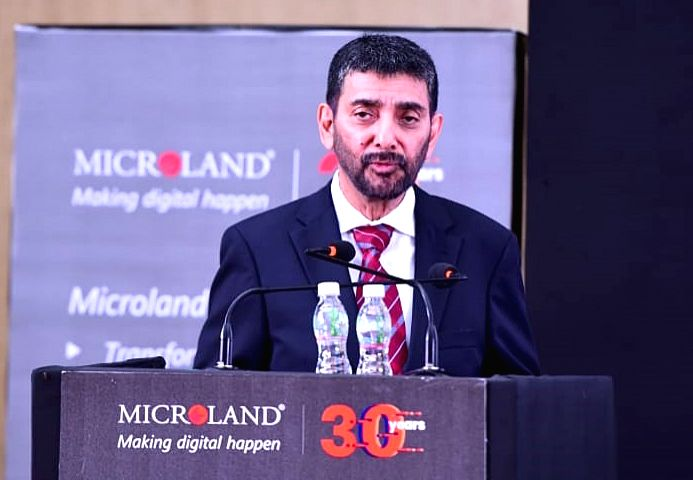 Mircoland Ltd. Founder, Chairman and MD Pradeep Kar addresses a press conference regarding company's 30th year anniversary celebration, in Bengaluru on Aug 26, 2019.