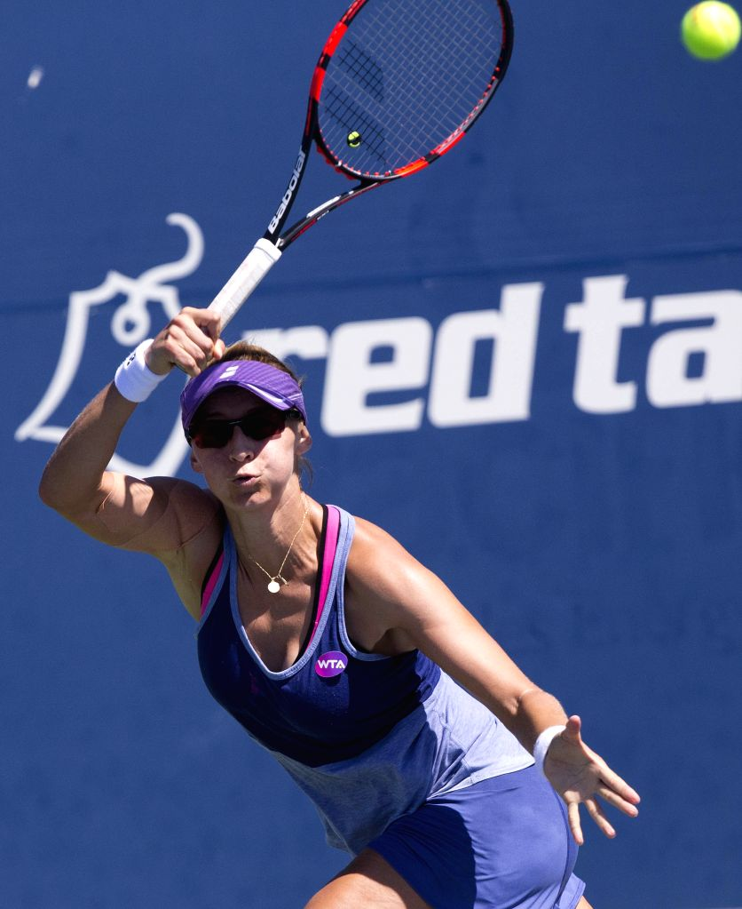 Mirjana Lucic-Baroni of Croatia returns the ball against Aliaksandra Sasnovich of Belarus during the second round of women's singles qualifying match at the 2015 ...
