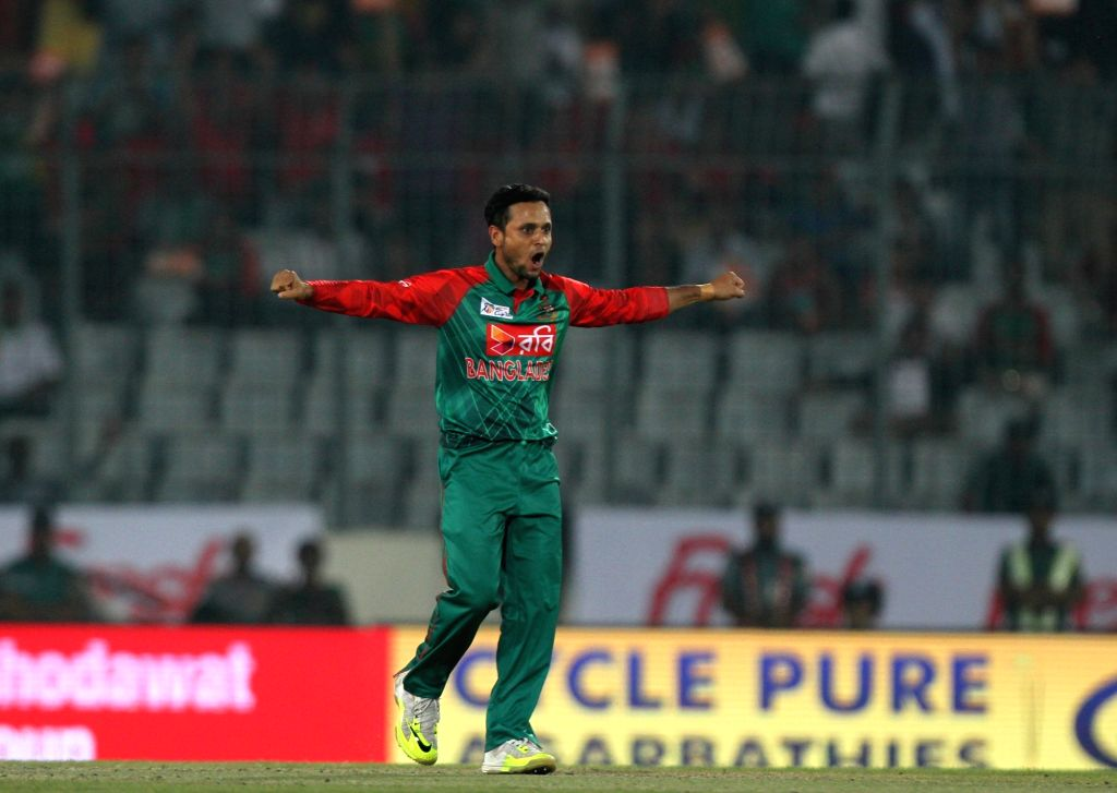 Mirpur: Bangladesh bowler Arafat Sunny celebrates fall of Khurram Manzoor's wicket during the eighth match of AsiaCup 2016 between Bangladesh and Pakistan in Mirpur of Bangladesh on March 2, 2016. (Photo: Surjeet Yadav/IANS) - Arafat Sunny and Surjeet Yadav