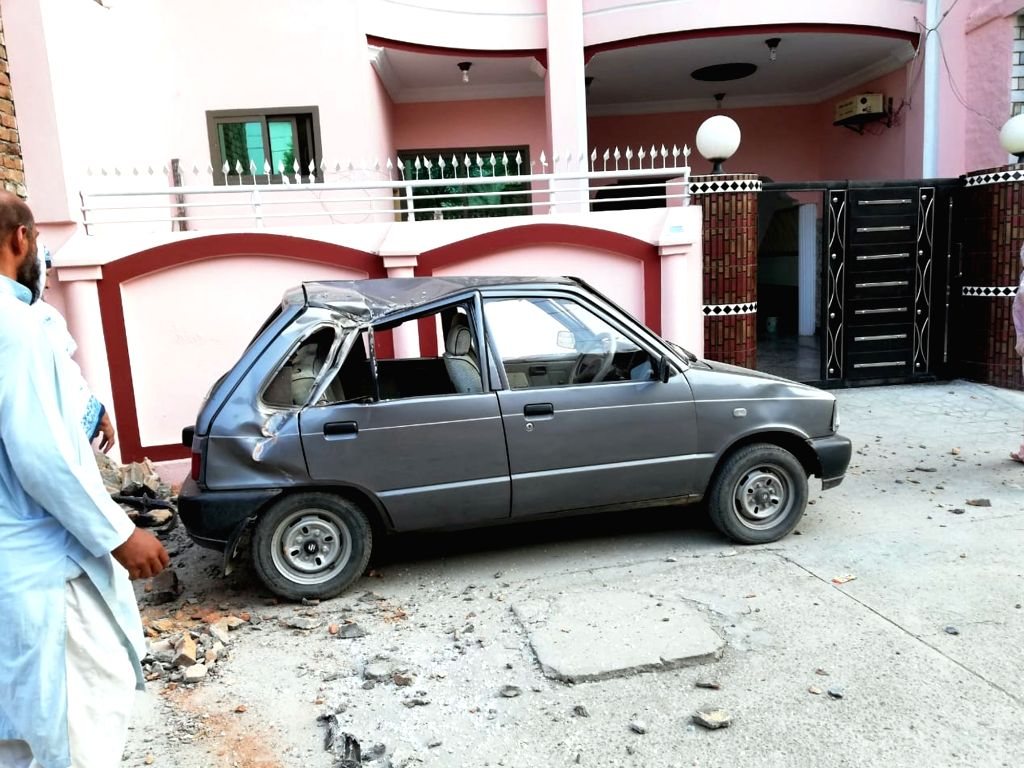 MIRPUR, Sept. 24, 2019 - Photo taken with a mobile phone shows a damaged car at the earthquake-hit area in Mirpur district of Pakistan-controlled Kashmir on Sept. 24, 2019. A 5.8-magnitude earthquake ...