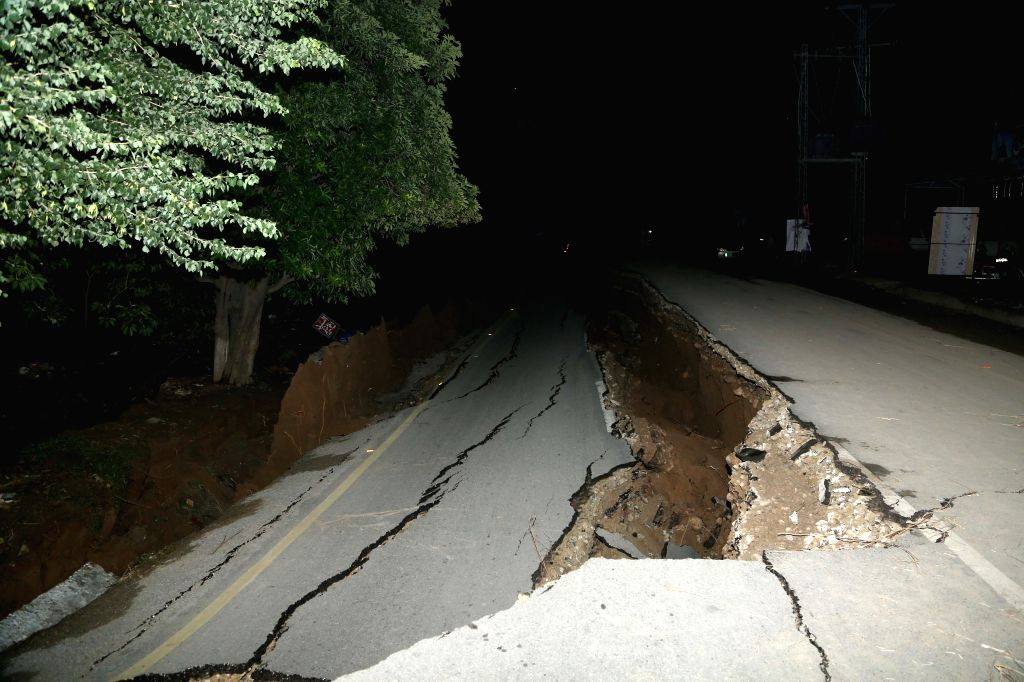 MIRPUR, Sept. 25, 2019 - A damaged road is seen at the earthquake-hit area on the outskirts of Mirpur district of the Pakistan-controlled Kashmir on Sept. 25, 2019. Rescue efforts are in progress ...