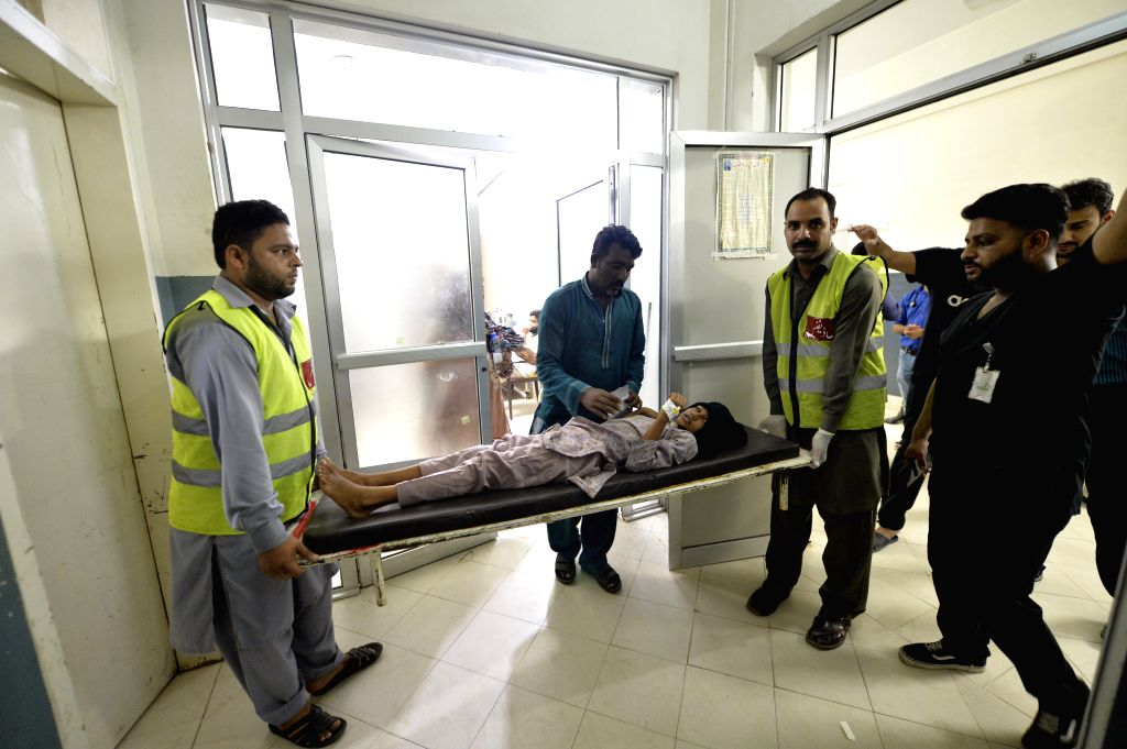 MIRPUR, Sept. 25, 2019 (Xinhua) -- Rescuers transfer an injured child to a hospital in Mirpur district of the Pakistan-controlled Kashmir on Sept. 24, 2019. The death toll from a 5.8-magnitude earthquake jolting parts of Pakistan and Pakistan-control
