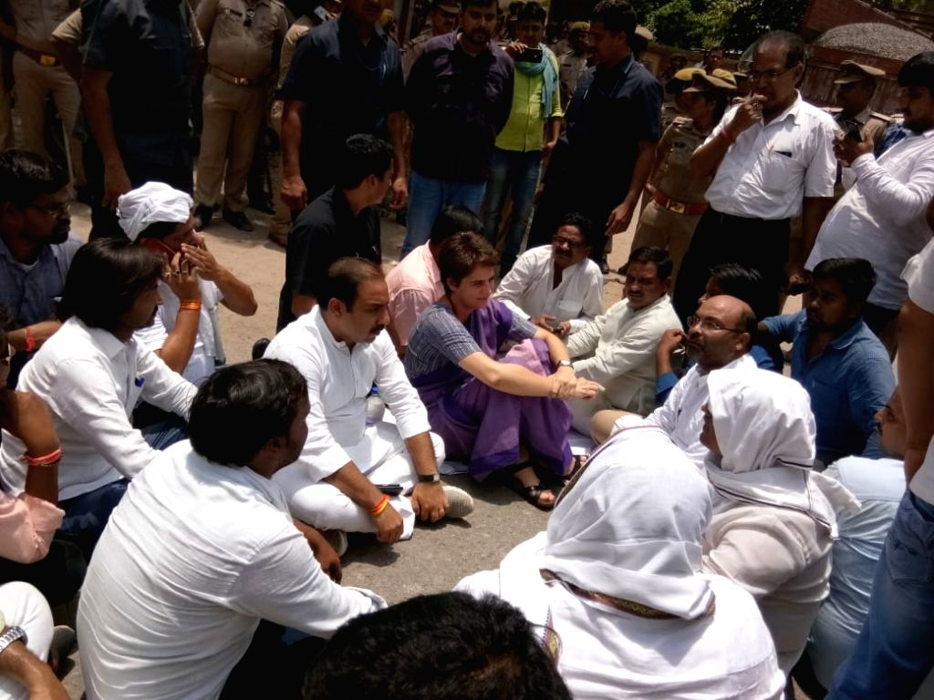 Mirzapur: Congress General Secretary Priyanka Gandhi accompanied by party supporters stage a sit-in demonstration after she was stopped for Ubhbha village in Mirzapur to meet survivors of caste violence, in in Narayanpur area of Uttar Pradesh's Mirza