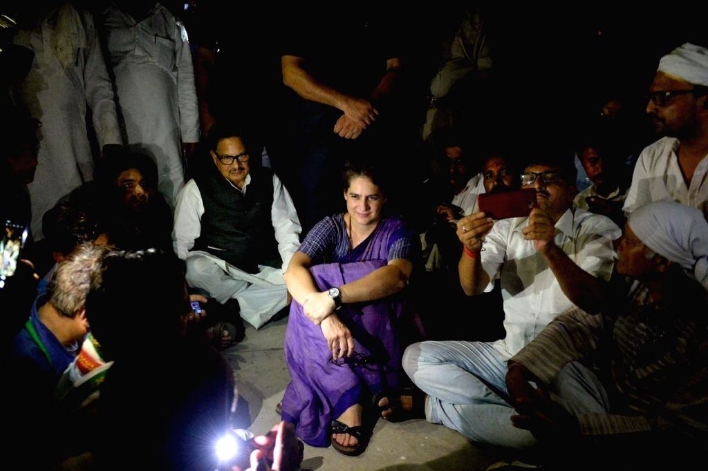 Mirzapur: Congress General Secretary Priyanka Gandhi accompanied by party supporters stage a sit-in demonstration after she was stopped for Ubhbha village in Mirzapur to meet survivors of caste violence, in Narayanpur area of Uttar Pradesh, on July 1