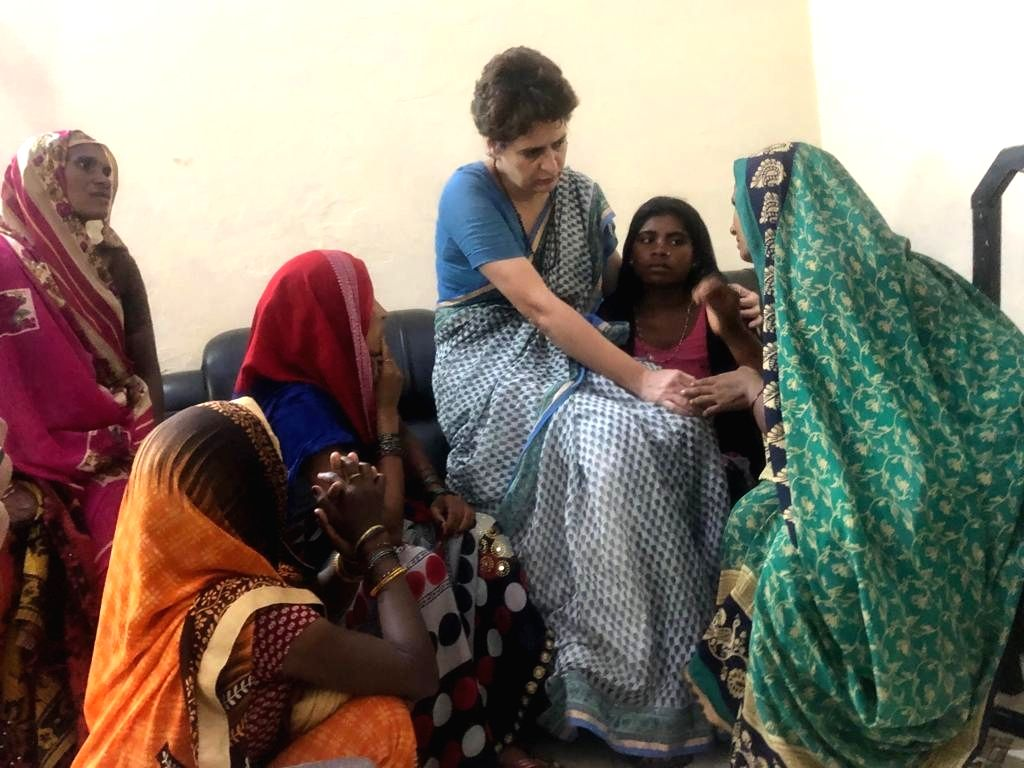 Mirzapur: Priyanka Gandhi Vadra, meets families of the Sonebhadra massacre victims at the Chunar Guest House in Mirzapur on July 20, 2019. Priyanka had been prevented from going to the Murtiya village in Sonebhadra by the district administration and  - Priyanka Gandhi Vadra