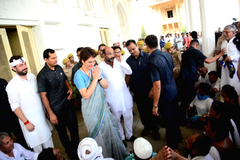 Mirzapur (UP): Congress General Secretary Priyanka Gandhi Vadra meets the family members of the victims of Sonebhadra carnage at Chunar fort in Uttar Pradesh's Mirzapur on July 20, 2019. About 15 family members of the victims of the Sonebhadra carnag