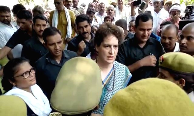 Mirzapur (UP): Congress General Secretary Priyanka Gandhi Vadra talks to the media at Chunar fort in Uttar Pradesh's Mirzapur on July 20, 2019. About 15 family members of the victims of the Sonebhadra carnage on Saturday arrived at Chunar fort where  - Priyanka Gandhi Vadra