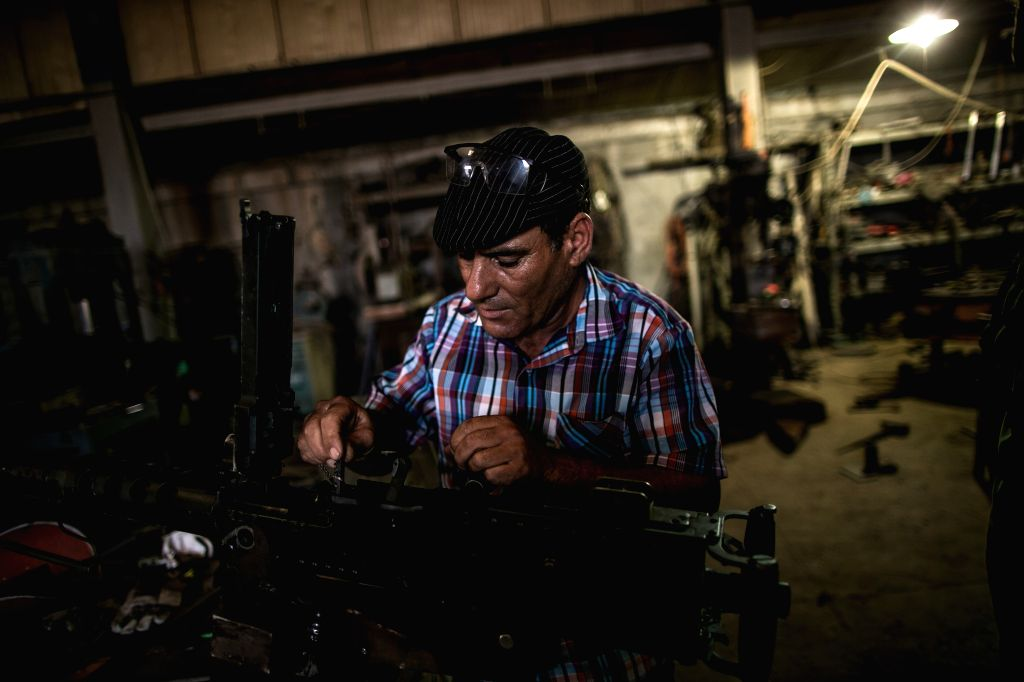 MISRATA (LIBYA), Sept. 1, 2019 A worker manufactures a weapon to be provided to Tripoli frontline troops loyal to the UN-backed Libyan Government of National Accord (GNA) at a local ...