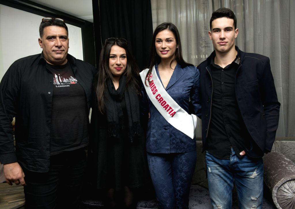 Miss Croatia 2015 Maja Spahija (2nd R) poses with her family members during a press conference in Zagreb, capital of Croatia, Nov. 18, 2015. Maja Spahija will ...