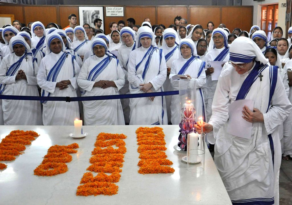 Missionaries of Charity Superior General Sister Mary Prema and others pay tribute to Mother Teresa on her 104th birth anniversary at the Mother House in Kolkata on Aug 26, 2014.