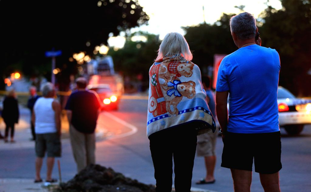 MISSISSAUGA, June 29, 2016 - People gather near the explosion site in Mississauga, Canada, on June 28, 2016. A person was killed and other nine were injured on Tuesday afternoon in an explosion, ...