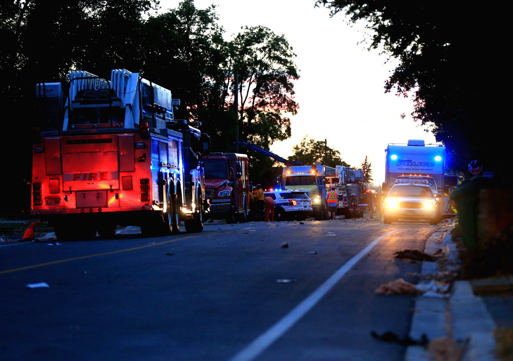 MISSISSAUGA, June 29, 2016 - Rescuers work near the explosion site in Mississauga, Ontario, Canada, on June 28, 2016. A person was killed and other nine were injured on Tuesday afternoon in an ...