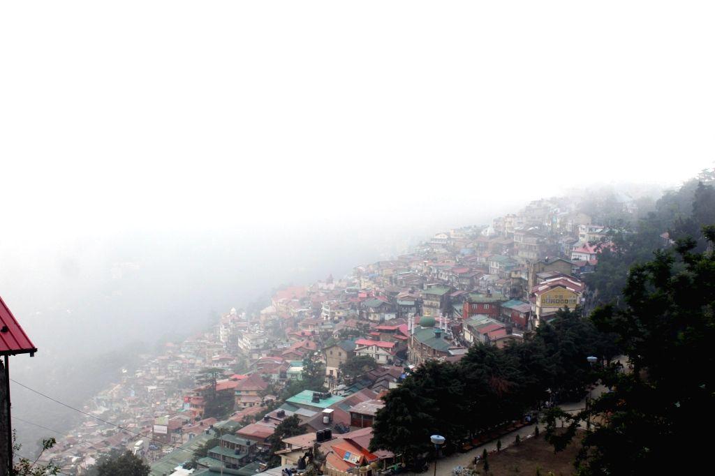 Mist covers Shimla on July 5, 2017.