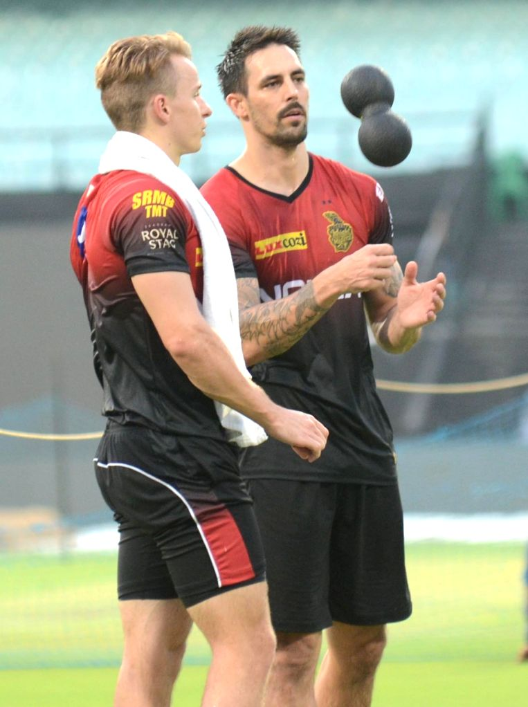 Mitchell Johnson and Tom Curran of Kolkata Knight Riders during a practice session, in Kolkata on May 21, 2018.