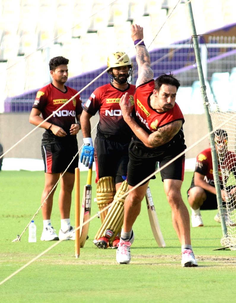 Mitchell Johnson, Dinesh Karthik and Kuldeep Yadav during a practice session at Eden Gardens in Kolkata, on April 13, 2018. - Kuldeep Yadav