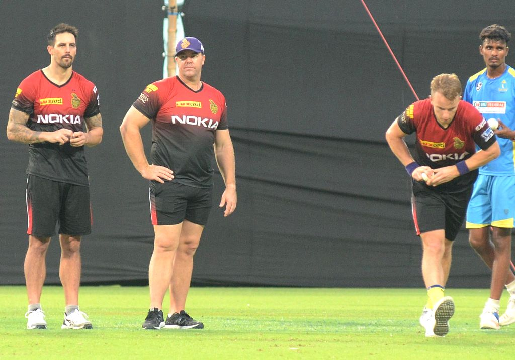 Mitchell Johnson, Heath Streak and Tom Curran of Kolkata Knight Riders during a practice session, in Kolkata on May 21, 2018.