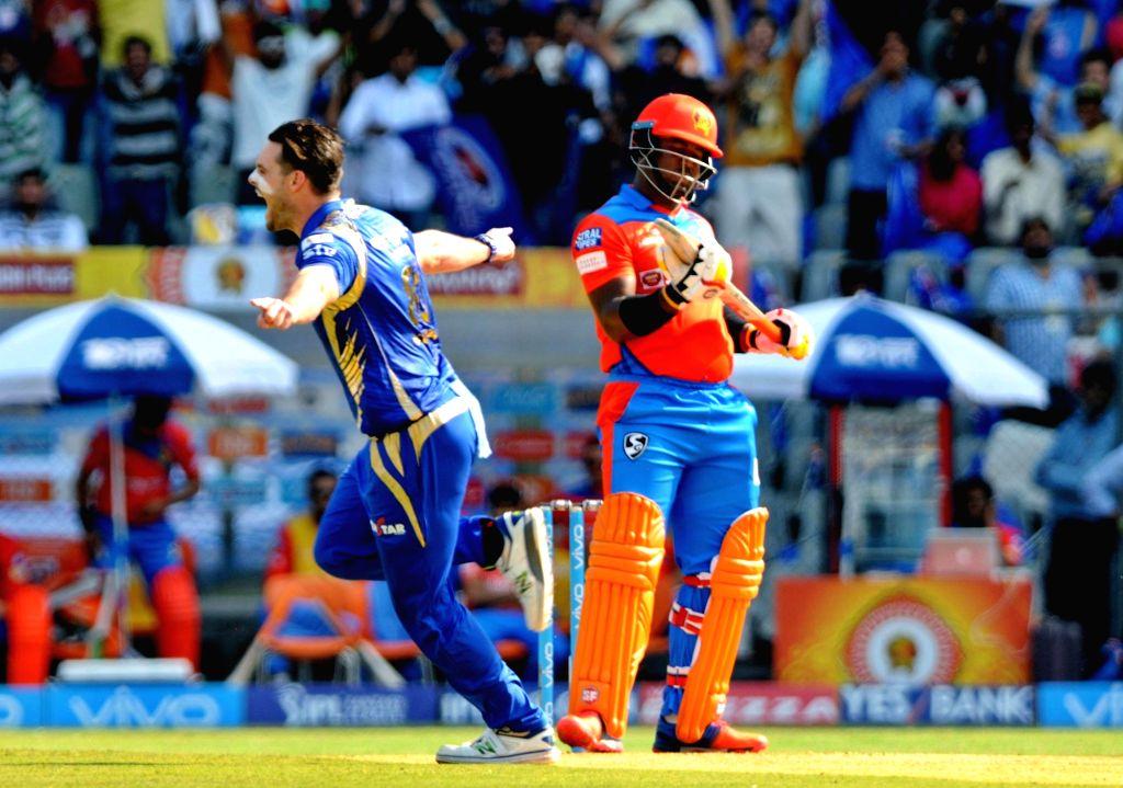Mitchell McClenaghan of Mumbai Indians celebrates fall of Dwayne Smith's wicket during an IPL 2017 match between Mumbai Indians and Gujarat Lions at Wankhede Stadium in Mumbai on April 16. ...