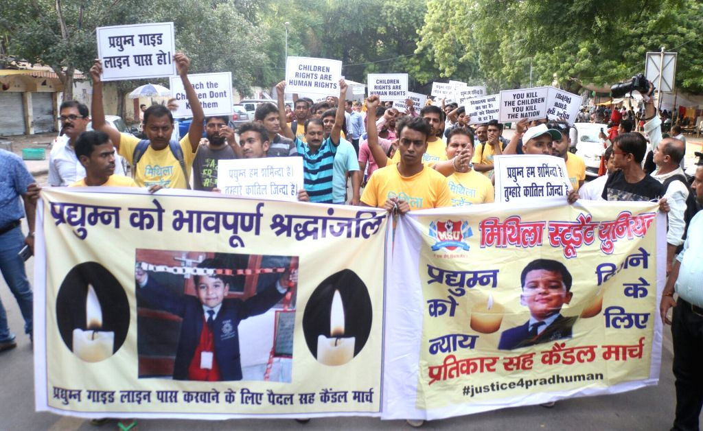 Mithila Student Union (MSU) activists carry out a candle light march over the killing of a Ryan International School student in New Delhi on Sept 17, 2017. Pradhuman, a Class 2 student, ...