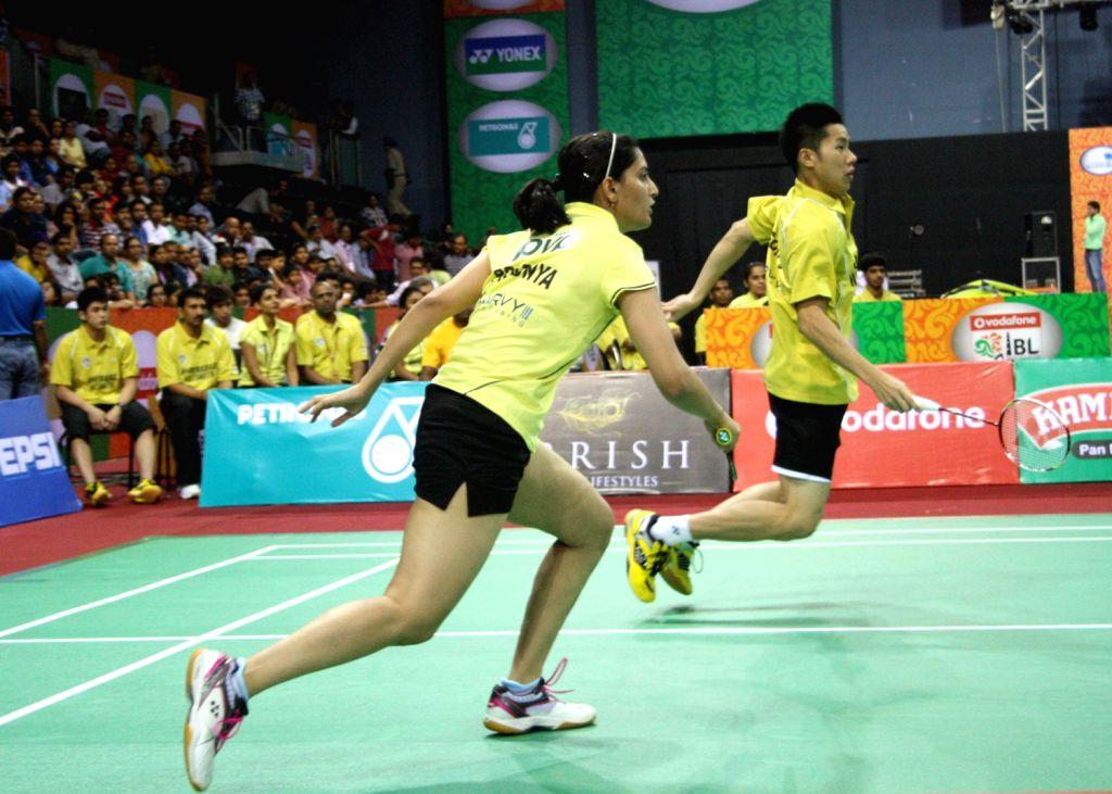 Mixed doubles::: V Shem Goh/Pradnya Gadre of Hyderabad Hotshots beat Marcis Kido/Sapsiree of Awadhe Warriors at the Indian Badminton League in New Delhi on August 15, 2013. (Photo::: IANS)