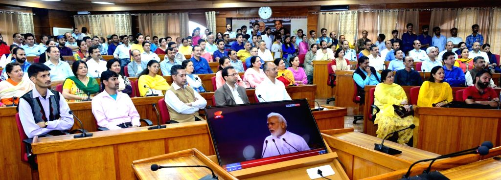 MLAs watch the broadcast of the launch of a nation-wide 'Fit India Movement' by Prime Ministyer Narendra Modi, at the Himachal Pradesh Assembly in Shimla on Aug 29, 2019. - Ministyer Narendra Modi
