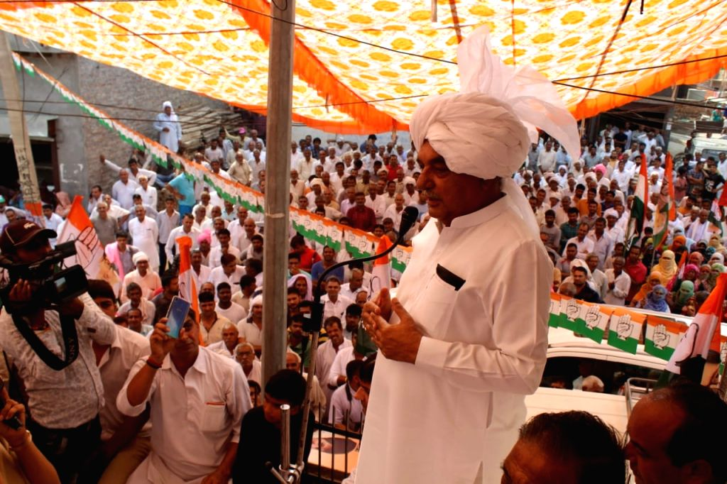 MMeham: Congress leader and star campaigner Bhupinder Singh Hooda addresses a gathering during an election rally ahead of Haryana Assembly polls, in Meham on Oct 17, 2019. The state will go to polls for the 90-member assembly on October 21. (Photo: I - Bhupinder Singh Hooda