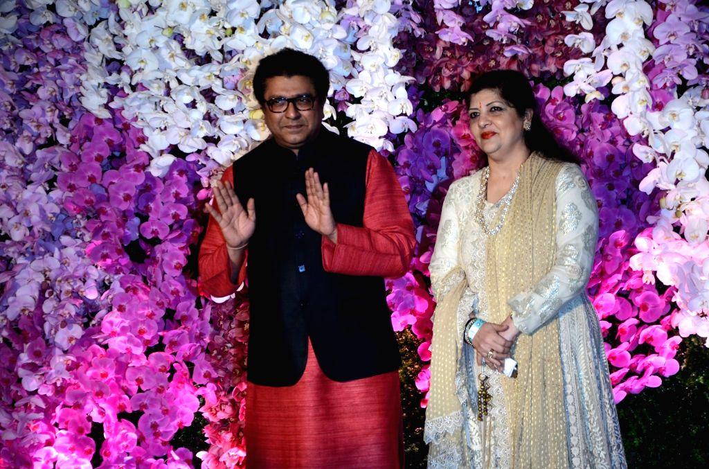 MNS chief Raj Thackeray along with his wife Sharmila Thackeray at the wedding reception of Akash Ambani and Shloka Mehta in Mumbai on March 10, 2019. - Akash Ambani and Shloka Mehta