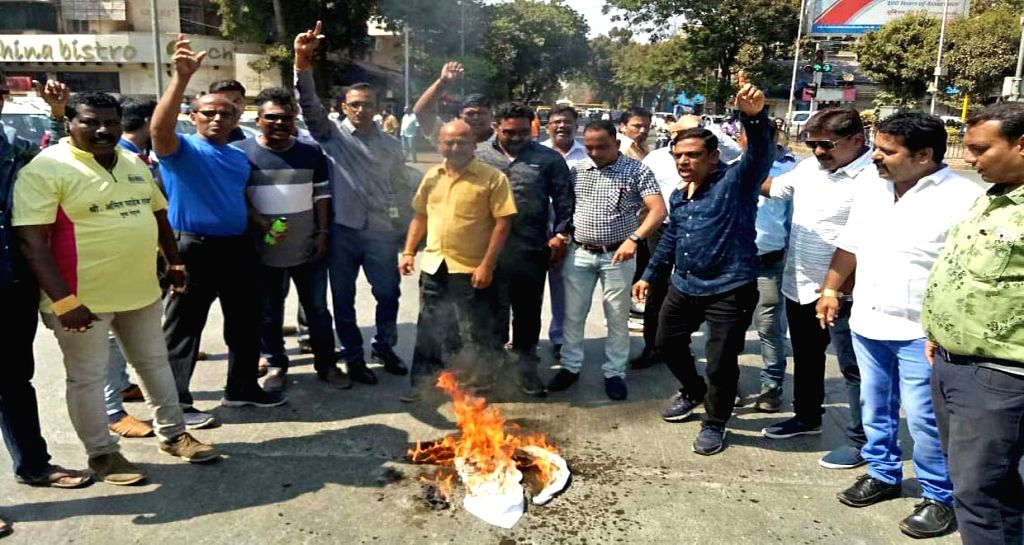 MNS workers stage a protest against suicide attack on a CRPF bus in Jammu and Kashmir's Pulwama district in which atleast 45 soldiers lost their lives; in Mumbai on Feb 15, 2019.