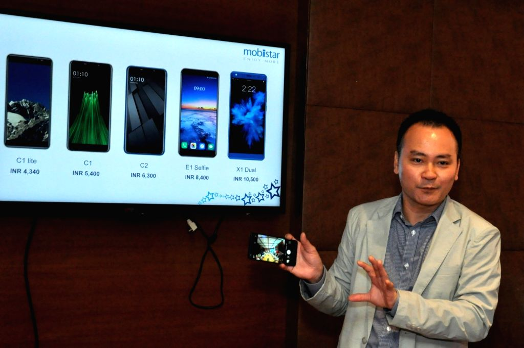 Mobiistar Co-founder and CEO Carl Ngo addresses during the launch of C1 Lite, C1 and C2, 'X1 Dual' and 'E1 Selfie' smartphones, in Kolkata on Sept 12, 2018.